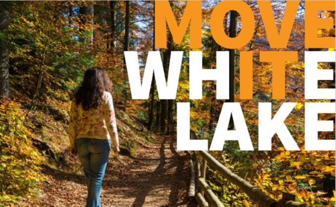 Move White Lake logo on photo of woman walking in the woods